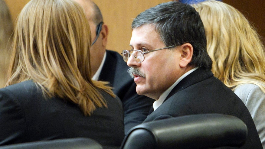 "Feb. 22: Faleh Hassan Almaleki sits with an attorney during his trial in Phoenix. A jury convicted Almaleki, a 50-year-old Iraqi immigrant, of second-degree murder for running over and killing his daughter in a case prosecutors called an ""honor killing."""