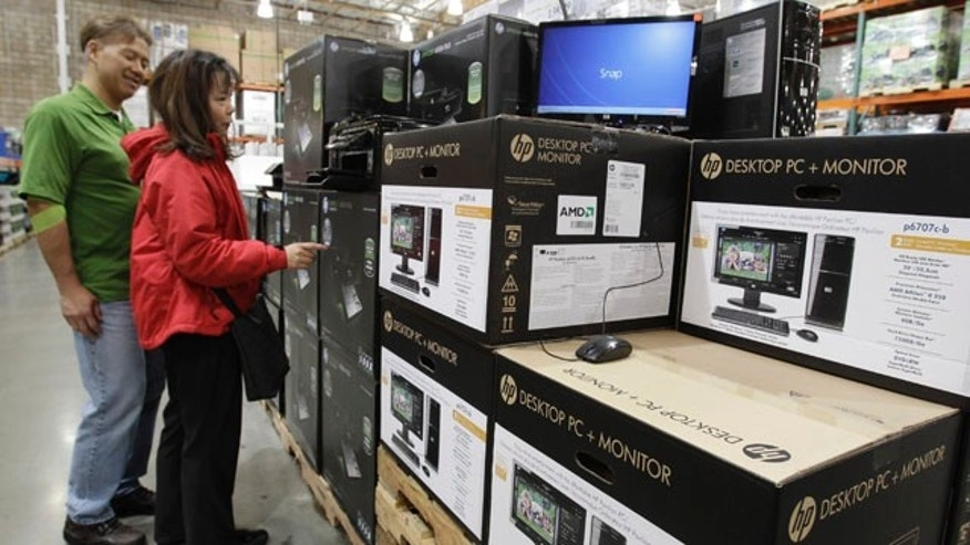 Feb. 18: Customers look at Hewlett-Packard Company printers, monitors and computers at Costco in Mountain View, Calif. Hewlett-Packard's fiscal first quarter results indicated that its revenue growth is slowing.