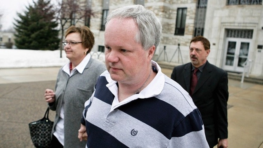 In this Feb. 17, 2011 file photo, William Melchert-Dinkel, center, leaves the Rice County Courthouse with his attorney Terry Watkins, right, and wife, Joyce Melchert-Dinkel, after waiving his right to a jury trial, in Faribault, Minn. Melchert-Dinkel, 48, of Faribault, faces two counts of aiding suicide, each carrying a maximum sentence of 15 years in prison. Prosecutors say he encouraged two people to take their lives, including 18-year-old Kajouji, of Brampton, Ontario, who jumped into a river in 2008; and 32-year-old Mark Drybrough, of Coventry, England, who hung himself in 2005. (AP/File)