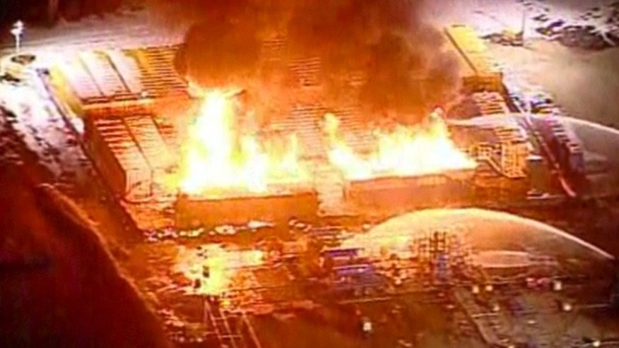 This frame grab from video provided by WPXI.com shows the gas well in Avella Penn. that exploded and caught fire injuring three workers Wednesday night Feb. 23, 2011. (AP/WPXI.com)