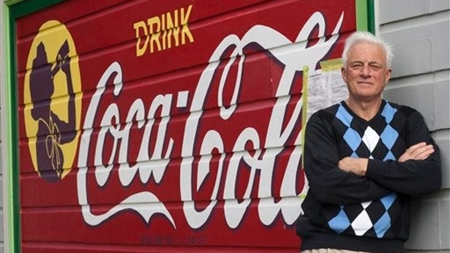 Feb. 23: Richard Modolo stands in front of a Coca-Cola sign that was painted on the side of his house decades ago when his home was the site of a mom-and-pop grocery store, in San Francisco. City officials say the painted sign in the Bernal Heights neighborhood violates anti-billboard laws and must come down. (AP/San Francisco Chronicle)