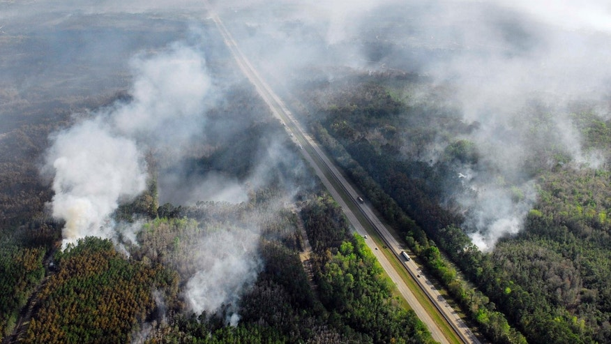 Mar. 1: Flames from a wildfire still burn on both sides of Interstate 95 in the north part of Brevard county as over 10,000 acres burn near the Volusia & Brevard County line in Scottsmoor, Fla.