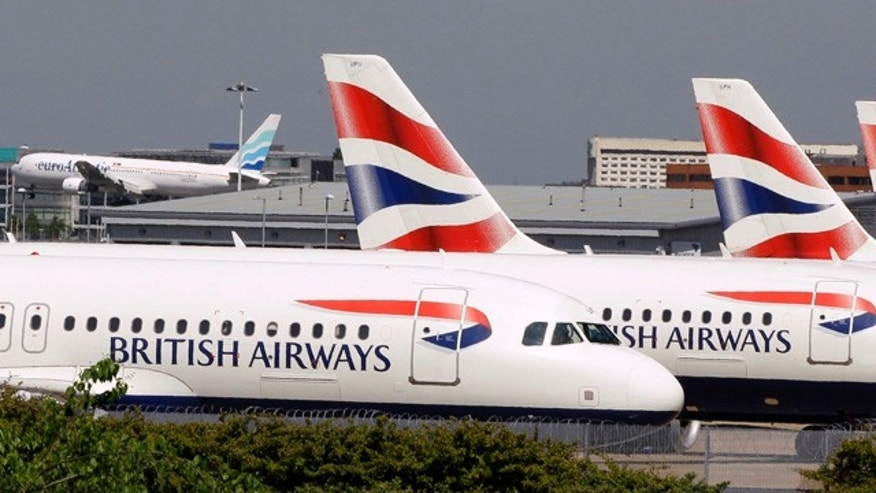 In this May 24, 2010 file photo, British Airways planes are seen parked at Heathrow Airport in London. According to federal prosecutors, when the airline industry took a nose dive a decade ago industry executives tried to fix it with a massive price-fixing scheme among airlines the world over, that artificially inflated passenger and cargo fuel surcharges to help companies make up for lost profits. Convicted airlines include British Airways, Korean Air, and Air France-KLM. No major U.S. carriers have been charged. (AP)