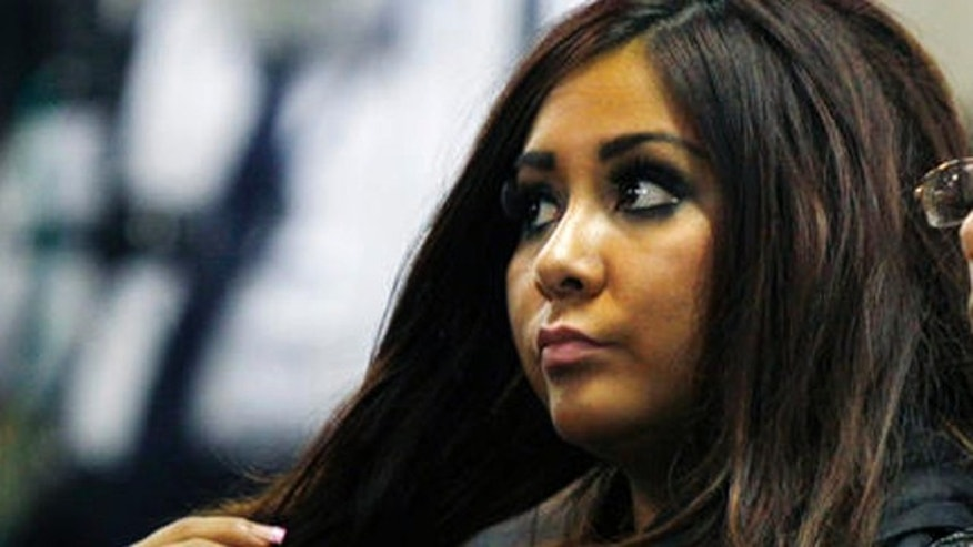 "Sept. 8, 2010: Nicole Polizzi, better known as ""Snooki"" from the MTV show ""Jersey Shore"" sits in court in Seaside Heights, N.J."