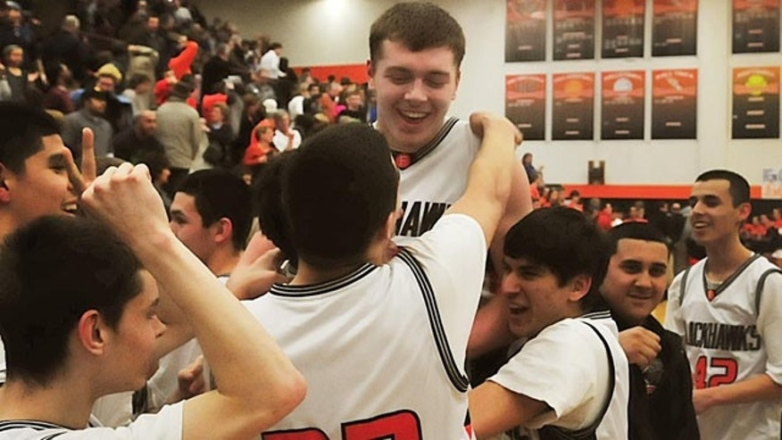 March 3, 2011: Members of the Fennville High School basketball team lift Wes Leonard, top, after he made a game-winning layup in overtime against Bridgman, in Fennville, Mich.