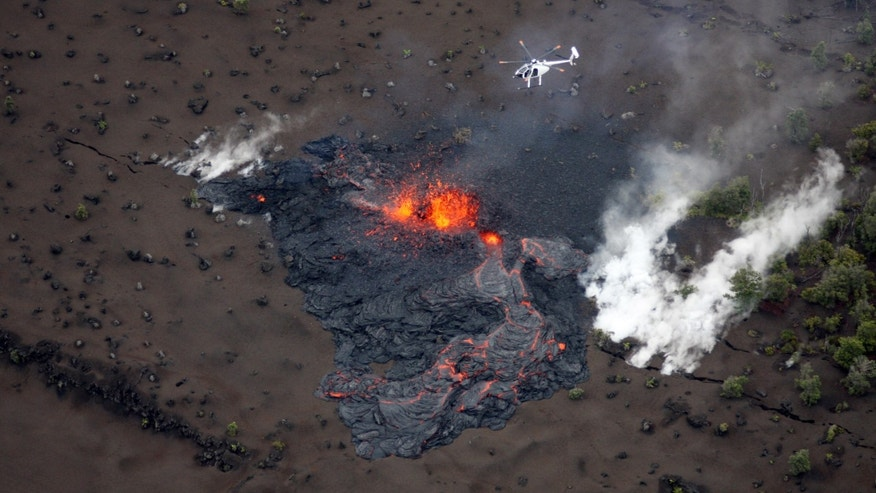 March 6: Scientists fly in a helicopter above the Pu'u O'o vent on Kilauea Volcano in Hawaii. Scientists say the Pu'u O'o crater floor has collapsed and an eruption occurred along the middle of Kilauea Volcano's east rift zone.