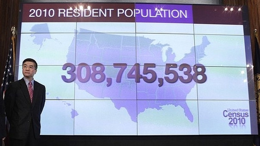 Dec. 21, 2010: U.S. Commerce Secretary Gary Locke stands beside a screen showing the country's resident population during the 2010 Census presentation at the National Press Club in Washington.