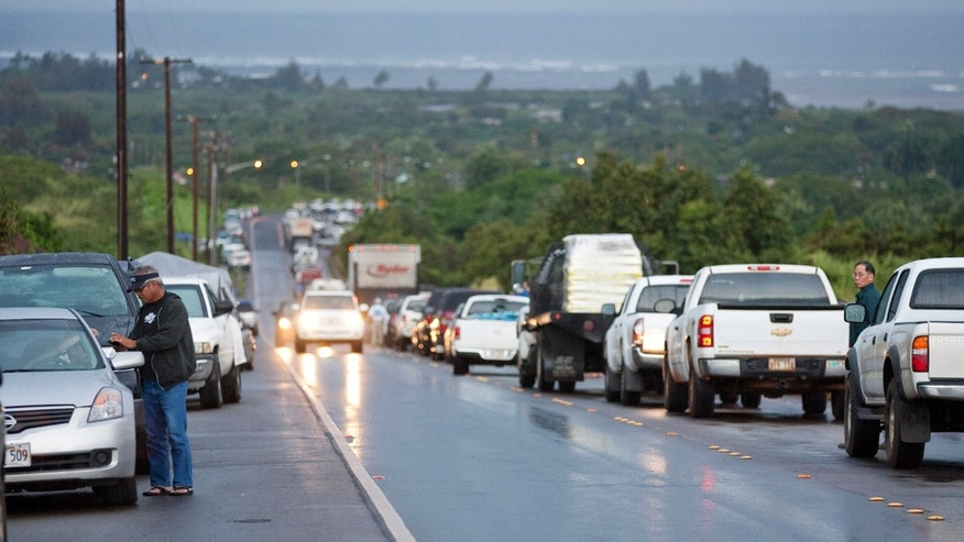 March 11: Due to a tsunami warning, hundreds of cars line Kamehameha Highway leading into the town of Haleiwa as residents of the north shore community wait for the all clear to return home in Honolulu. An 8.9-magnitude earthquake struck Japan and sent a tsunami wave across the Pacific.