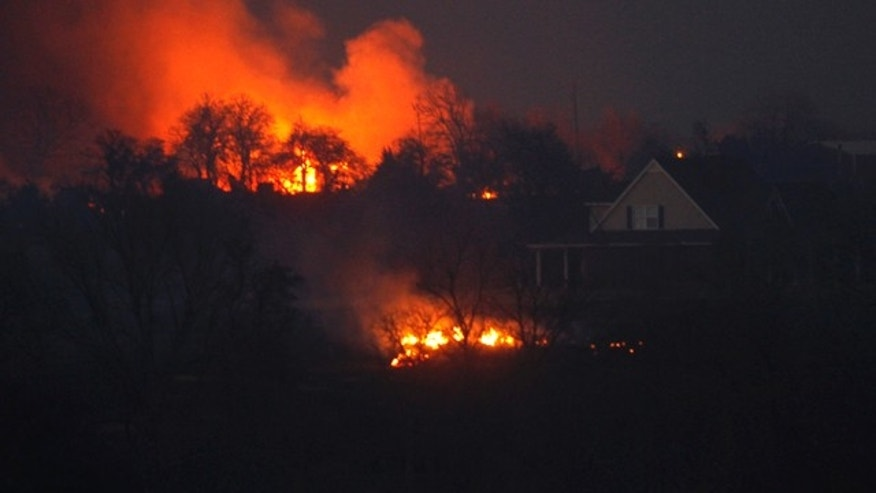 March 11: A grass fire burns near a home near Harrah, Okla.