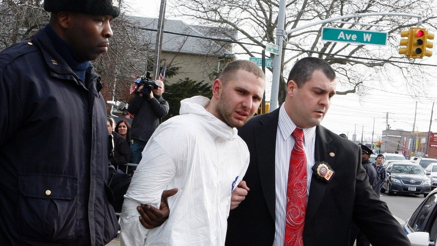 Feb. 13: Maksim Gelman of Brooklyn, center, who is accused of going on a 28-hour stabbing rampage through New York City, is lead by officers in Brooklyn, N.Y. Authorities said in a court document released March 15 that Gelman told police he had cancer, lamented his family life, said he wished police had shot him, and declared he had experienced 'a doozy of a day.'