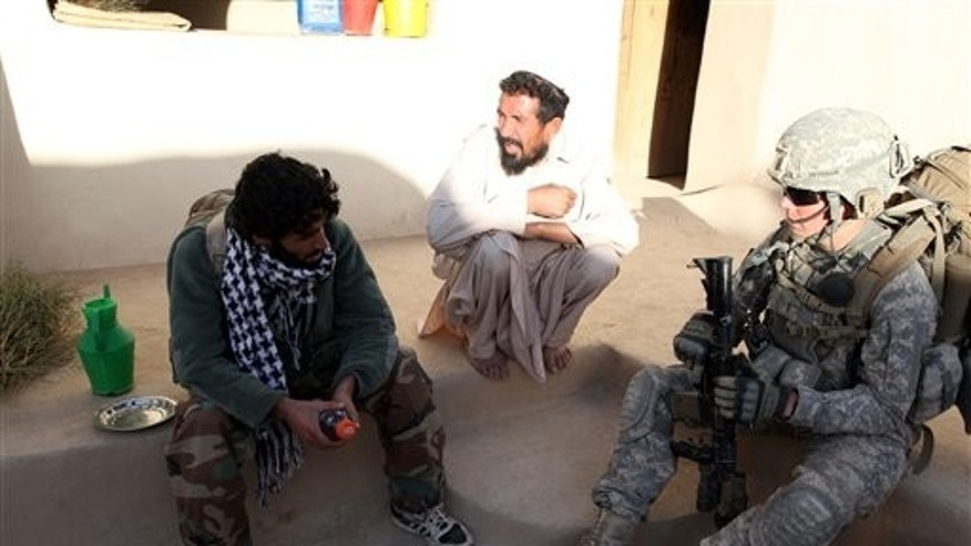 Sept. 24, 2010: In this image released by the U.S. Army, Army 2nd Lt. Stephen Petraeus from Alpha Company, 3rd Platoon, 1st Battalion, 503rd Infantry, 173rd Airborne Brigade Combat Team, speaks to an Afghan local national as his house is searched in the Chak District of Wardak province, Afghanistan. Challenged by a congressman to be honest about how long American troops might have to fight in Afghanistan, Army Gen. David Petraeus revealed that he has a special ally in his belief that U.S. war objectives are important - his son, Stephen, whose recent combat tour was kept very quiet. (AP/U.S. Army)