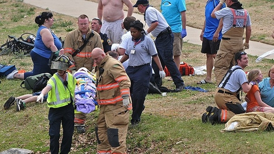 March 19: Rescue workers carry an injured child after a children's train ride at Cleveland Park derailed in Spartanburg, S.C.