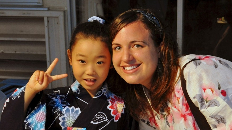 In this July 17, 2010 photo provided the Anderson family, Taylor Anderson, right, poses with one of her students in Ishinomaki, Japan.