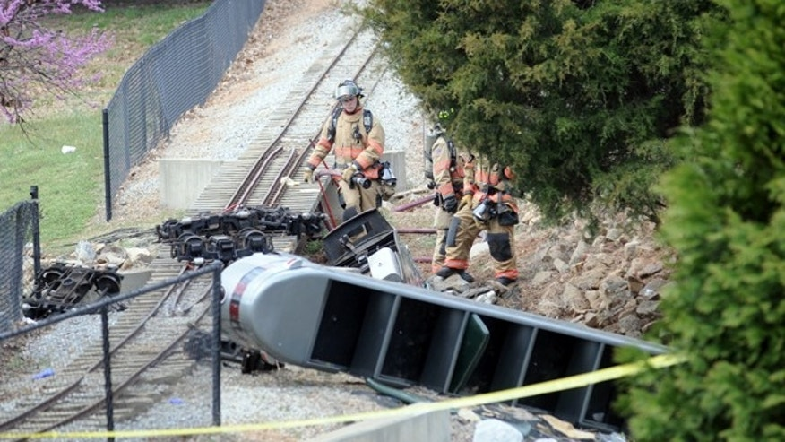 Rescue workers look over the scene of an accident after a children's train ride at Cleveland Park derailed Saturday, March 19, 2011 in Spartanburg, S.C.