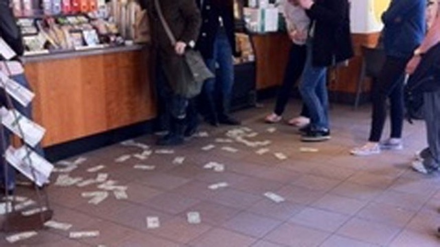 A mystery man walked into a local Starbucks in Boston and threw about $100 up in the air and walked out.