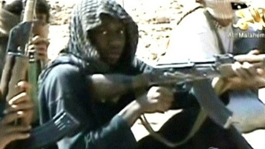 In this video still provided by ABC News from a video produced by Al Qaeda, accused underwear bomber Umar Farouk Abdulmutallab and others in his training class fire weapons at a desert camp in Yemen.