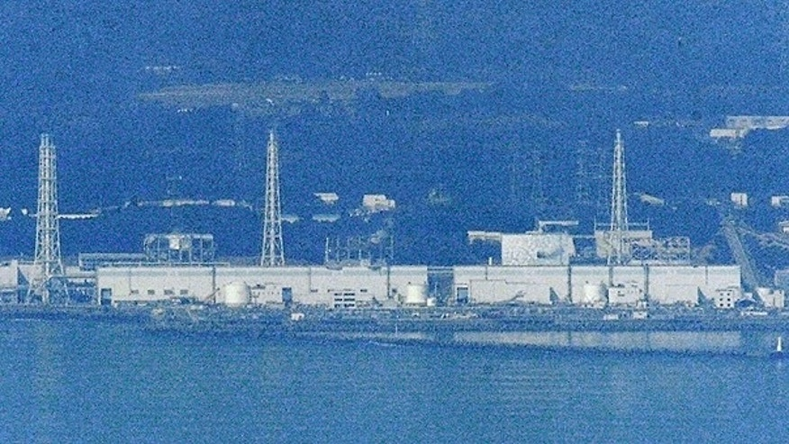 March 29: Only Unit 2 is covered with white concrete housing, seen on left of an iron tower on right, at the stricken Fukushima Dai-ichi nuclear power plant in Okumamachi, Fukushima prefecture.