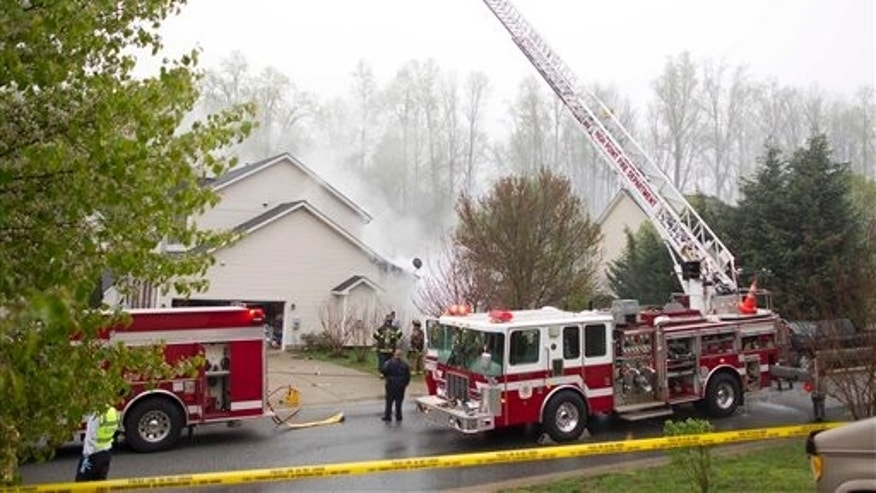 March 30: Emergency officials work at the scene of a small plane that crashed into a House in High Point, N.C.
