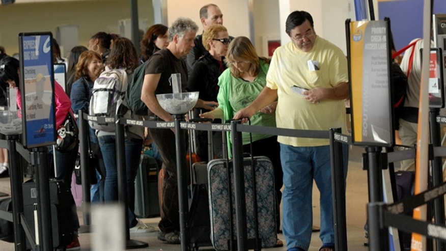 April 2, 2011: Southwest Airlines customers wait in long lines to find out their flight was either changed or canceled at Oakland Airport in Oakland Calif.
