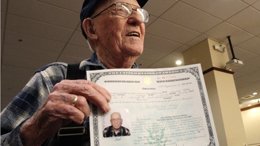 April 5, 2011: Leland Davidson, 95, of Centralia, Wash., displays his certificate of citizenship after he took part in a ceremony to award his certificate of U.S. citizenship in Seattle. Leland was born in Canada to parents who were both citizens, but until now, his U.S. citizenship had not been formally documented.