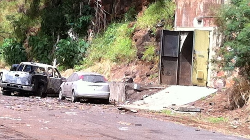 April 8: This image shows the entrance to the bunker where fireworks were stored at Waikele Business Center in Waipahu, Hawaii. At least two men were killed, injuring two others and two are missing after the explosion.
