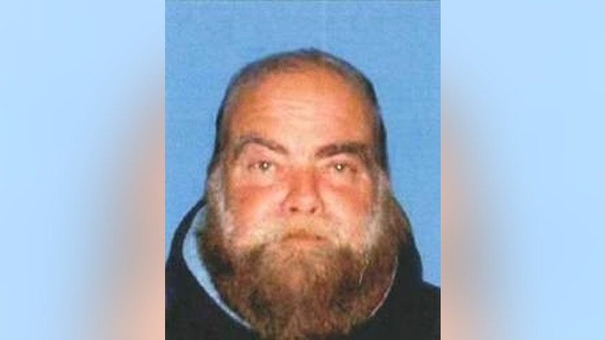 This undated booking photo provided by the Santa Monica Police Department shows Ron Hirsh, 60, who is wanted by the Santa Monica Police Department in connection with an explosion outside the Chabad House, a synagogue, in Santa Monica. (AP/Santa Monica Police Department)
