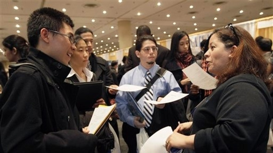 April 8: A recruiter speaks to job applicants during the 23rd annual CUNY Big Apple Job Fair, at the Jacob K. Javits convention center in New York.