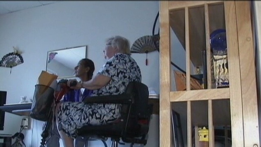 Disabled 79-year-old Florence with neighbor Renee Blackwell.