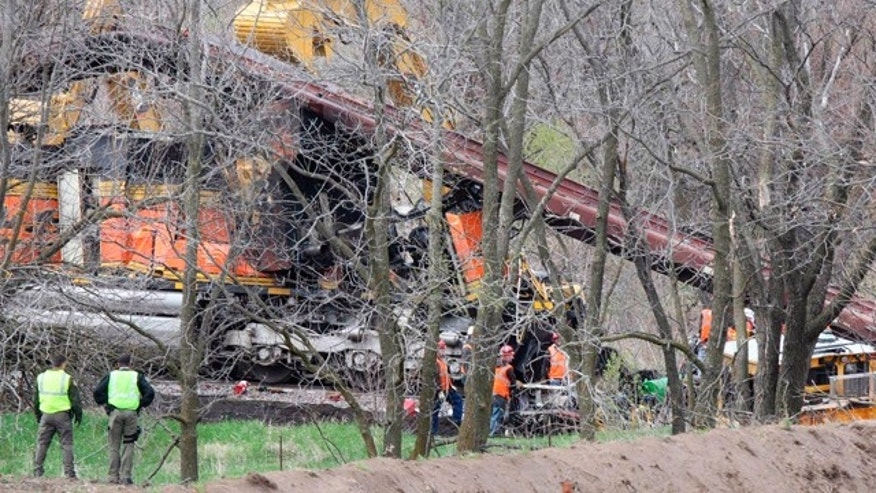 April 17, 2011: Repair crews start the clean up effort at the scene of a train accident near Red Oak, Iowa