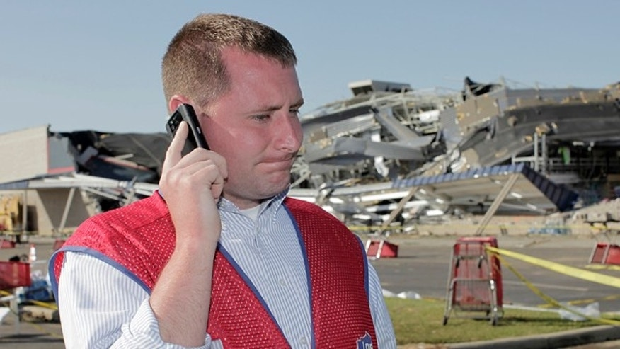 April 17, 2011:Lowe's store manager Mike Hollowell, who directed dozens of customers to safety when a tornado struck the Sanford, N.C., hardware store the previous day, recounts the scene during a radio interview