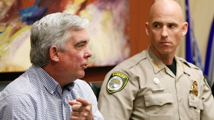Nov. 1, 2010: Cochise County Sheriff Larry Dever, left, speaks about illegal immigration at an event in Arizona also attended by Pinal County Sheriff Paul Babeu.