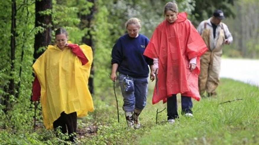 April 15: Search teams in Parsons scour a rural road for evidence in the disappearance of Holly Bobo (AP).