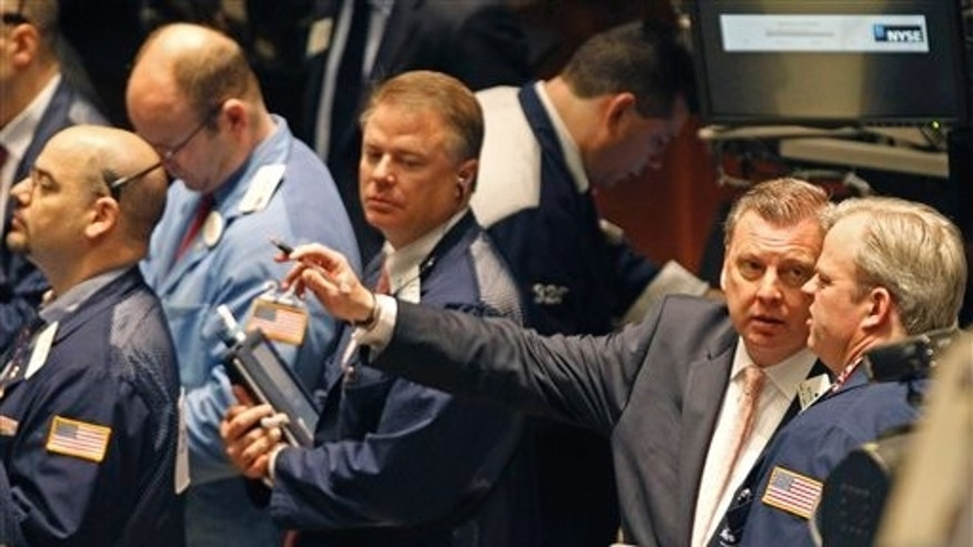 April 19: Traders work on the floor of the New York Stock Exchange.