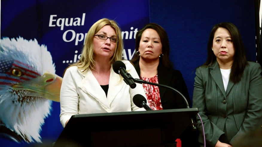 April 20: Kay Buck, left, executive director of the Coalition to Abolish Slavery Trafficking, speaks at a news conference to announce the filing of a human trafficking lawsuit that stretches across California , Hawaii, and Washington. Anna Park, regional attorney for the EEOC in the Los Angeles District, center, and Chanchanit Martorell, executive director for the Thai Community Development Center, listens in. (AP)