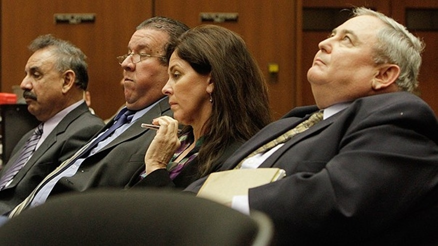 Feb. 23: Bell City executives (from r.) Administrator Robert Rizzo; former Assistant City Administrator Angela Spaccia; Luis Artiga and Oscar Hernandez listen during a preliminary hearing for the four, who are charged with misappropriation of public funds in Los Angeles.