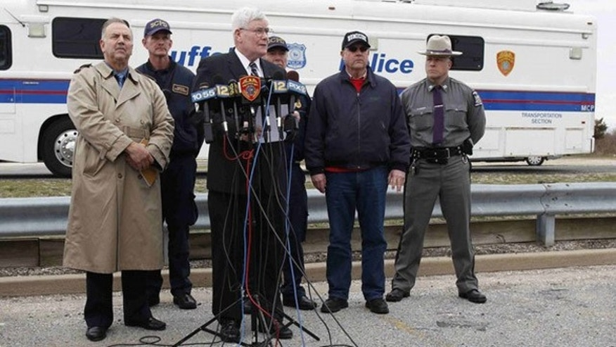 April 7: Suffolk County Police commissioner Richard Dormer holds a news conference on the investigation in Oak Beach, N.Y. (Reuters).
