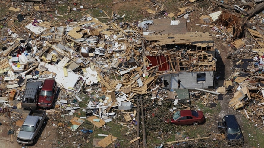 This is an aerial view of tornado damage as residents in Tuscaloosa, Ala., continue the process of cleaning up Saturday, April 30, 2011. Hundreds of people were killed across the South when a swarm of tornadoes hit on Wednesday. (AP Photo/Dave Martin)