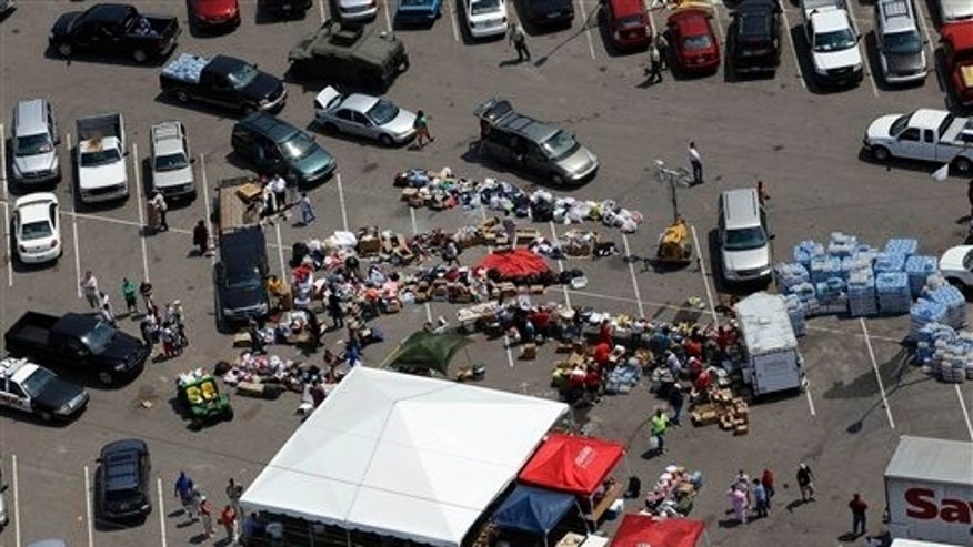April 30: Tuscaloosa residents gather in a parking lot where food, water, and supplies are being distributed to those in need in Tuscaloosa, Ala.. (AP)