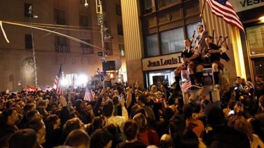 May 2: A large, jubilant crowd reacts to the news of Usama Bin Laden's death at the corner of Church and Vesey Streets, adjacent to ground zero (AP).