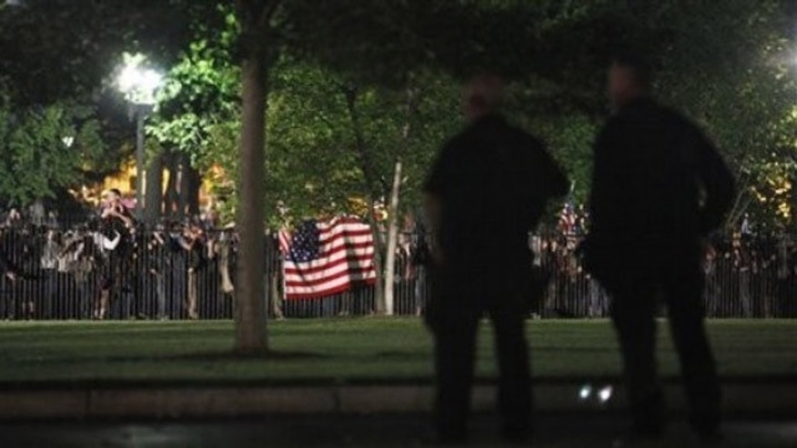 Secret Service Police watch the crowd celebrating outside the White House in Washington early Monday after President Obama announced the death of Usama bin Laden (AP).