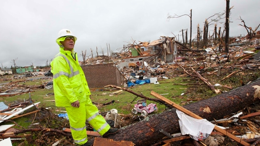 May 3: Lineman Derrick Heisz of Broadhead, Wis., surveys the damage in Pratt City, Ala.