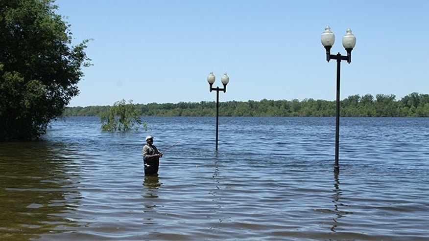 May 2: Angler Jessie Wilson waded off the levee into what was the parking area on the Greenville, Miss. waterfront to fish.