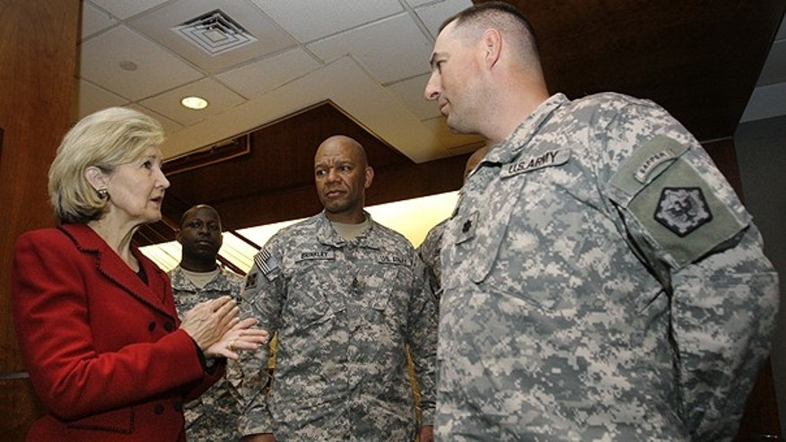 May 2: Sen. Kay Bailey Hutchison, R-Texas, left, talks with U.S. Army Lt. Col. John Buck, right, with the 14th Combat Engineer Battalion out of Fort Lewis, Washington and other soldiers in the USO holding area at DFW International airport.