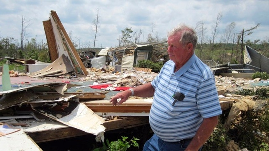 May 2: Kenneth Carter, 74, walks through the wreckage of his house in Apison, Tenn. Two looters tried to steal an all-terrain vehicle from his property shortly after it was struck by a tornado on April 27.