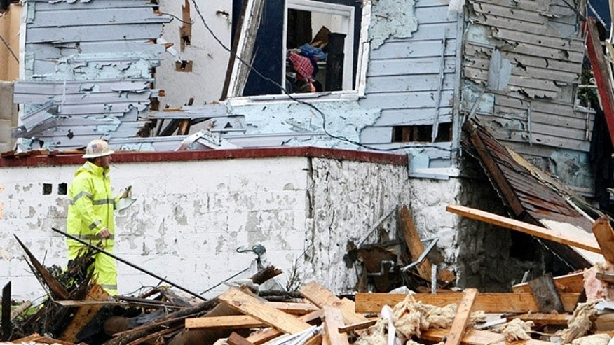 May 3: A Natural gas worker inspects a house that was destroyed when a tornado ripped through Pratt City. (AP)