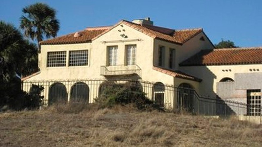 This undated photo provided by Autumn Norris-Makin shows a five-bedroom, Mediterranean-style mansion once owned by Khalil bin Laden, one of Osama bin Ladens brothers. Khalil, one of the terrorist masterminds 54 siblings, bought the home in 1980 for $1.6 million, but the wealthy businessman and his family fled their vacation spot under police escort shortly after 9/11, fearing they might be targeted because of the terror attacks. The 1920s-era mansion has sat empty ever since. (AP Photo/Autumn Norris-Makin)