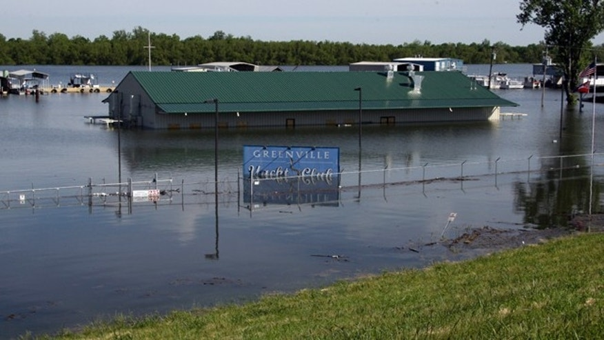 May 5: The rising waters of Lake Ferguson flood the Greenville Yacht Club and are forcing the evacuation of its neighbor the Lighthouse Point Casino, in Greenville, Miss.