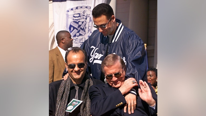 FILE - In this Oct. 29, 1999 file photo, New York Yankees shortstop Derek Jeter, rear, greets manager Joe Torre, left, and team owner George Steinbrenner at the start of the rally at City Hall honoring the 1999 World Champions New York Yankees in New York. A person close to George Steinbrenner says the Yankees owner died Tuesday, July 13, 2010.  (AP Photo/Richard Drew, File)