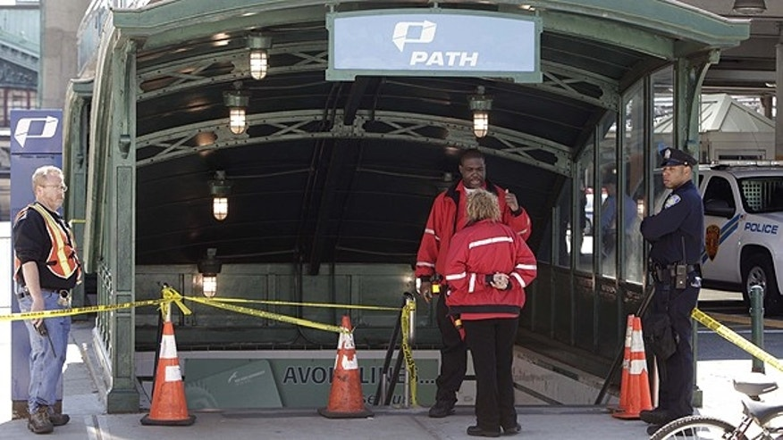 May 8: Emergency personnel gather near the entrance to the PATH station in Hoboken.
