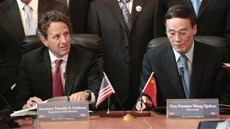 May 10: Treasury Secretary Timothy Geithner and Chinese Vice Premier Wang Qishan take part in a signing ceremony in the Cash Room of the Treasury Department during the US-China Strategic and Economic Dialogue meetings in Washington.